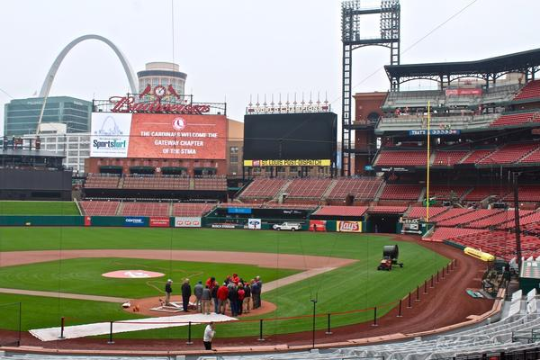 The grounds crew works on the field at Busch Stadium before opening day, 2017.