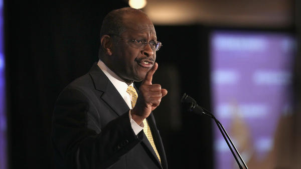 Former Republican presidential candidate Herman Cain addresses the Americans for Prosperity Presidential Forum on Feb. 25, 2012, in Troy, Mich. President Trump says he plans to nominate Cain to a vacant spot on the Federal Reserve Board.