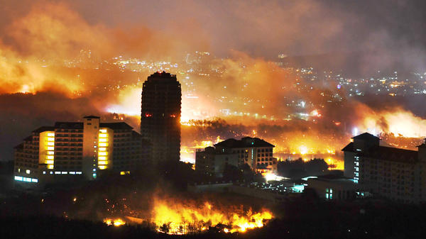 A forest fire is seen raging near buildings in Sokcho, South Korea. South Korea mobilized troops and helicopters to deal with the massive blaze that roared through forests and cities along the eastern coast.