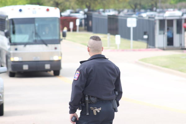 "Buses, at least one of which said LaSalle Corrections Transport, left CVE a few hours after the raid began, presumably with undocumented workers inside. Some demonstrators yelled toward one of the buses, ""We see you, we love you."""