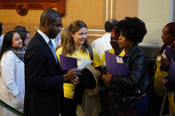 Advocates who turned out to the state Capitol to argue for greater funding for early childhood programs speak with state Rep. LaShawn Ford, a Chicago Democrat.