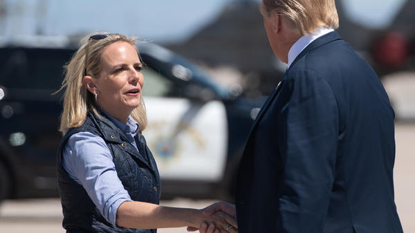 Secretary of Homeland Security Kirstjen Nielsen shakes hands with President Trump in El Centro, Calif., on April 5 after he arrived to visit the border wall between the United States and Mexico.