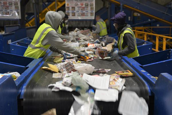 Sorting recyclable items at the Southeastern Oakland County Resource Recovery Authority's material recovery facility.