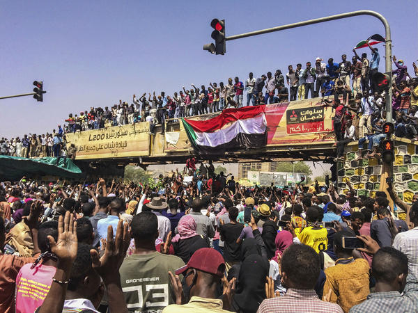 Protesters rally near the military headquarters on Tuesday in Khartoum, Sudan. Activists behind the anti-government protests say that security forces killed 14 people on Tuesday as troops moved to break up the demonstration.