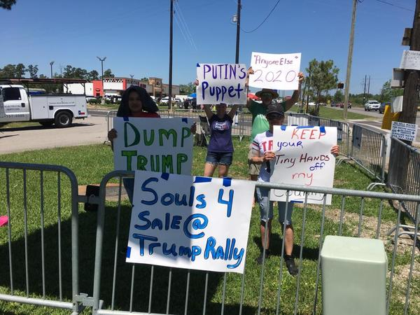 Not everybody was happy about the presidential visit. There were also some people who displayed signs critical of Trump.