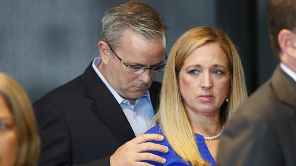 Lisa and Richard Olson, whose son was injured during last year's Parkland, Fla., school shooting, look on during a news conference Wednesday in Fort Lauderdale, Fla. Lisa Olson spoke about how difficult it has been for her family to cope with the lingering effects of the trauma.