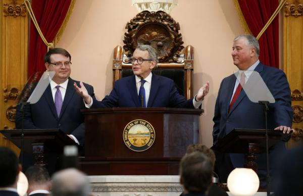 Gov. Mike DeWine, center, speaks between Ohio Senate President Larry Obhof, left, and Ohio House Speaker Larry Householder during the Ohio State of the State address at the Ohio Statehouse in Columbus, Ohio, Tuesday, March 5, 2019.