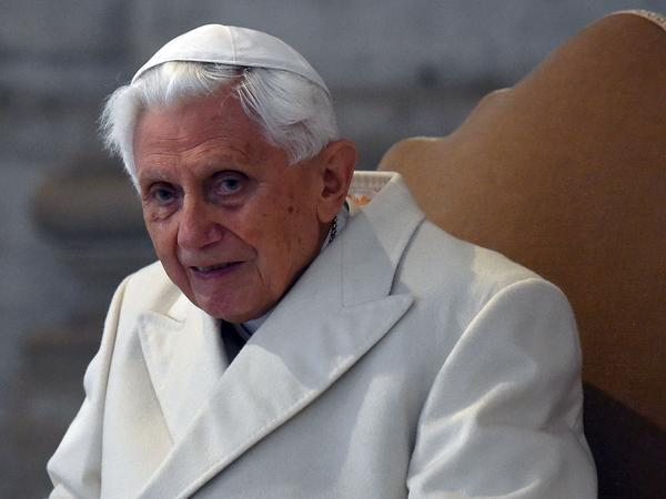 Pope Emeritus Benedict XVI arrives at St Peter's basilica in 2015. Benedict has stayed largely silent on the church's sex abuse scandal for the past six years.