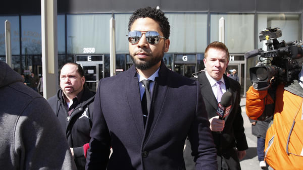 Actor Jussie Smollett leaves a courthouse last month in Chicago. On Thursday, the city sued him to recoup costs of a police investigation that followed what the city says was his false report that he'd been attacked.