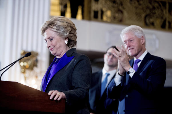 Hillary Clinton, with former President Bill Clinton behind her, pauses during her speech conceding her defeat to Republican Donald Trump after the 2016 presidential election.