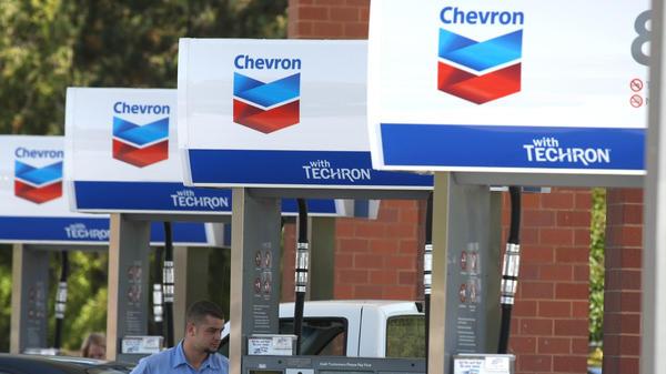 A Chevron customer pumps gas into his car in 2009 in Greenbrae, Calif. Chevron is acquiring Anadarko Petroleum for $33 billion in cash and stock.