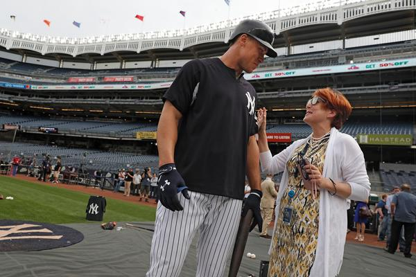 Jean Afterman talks with New York Yankees outfielder Aaron Judge. Afterman is in her 18th season with the Yankees, and was a player agent prior to becoming MLB's third female assistant general manager. She's also a senior VP.