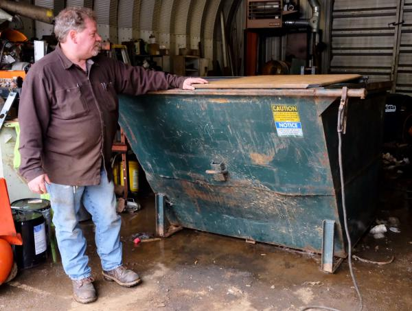 Darrel Yeargle runs Whitings Rubbish Removal, a waste hauler based in Littleton. He's been scrambling, he says, to replace the plastic lids on his dumpsters with bear-proof metal ones he makes by hand in his shop.