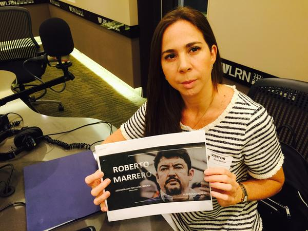 Romy Moreno with a picture of her husband, jailed Venezuelan opposition leader Roberto Marrero, at the WLRN studios in Doral.