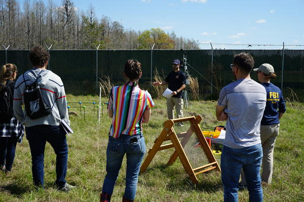 USF forensic anthropology students and FBI agents learn crime scene mapping skills at the annual field day at the Facility for Outdoor Research and Training (FORT). NOTE: Some of these photos include graphic content.
