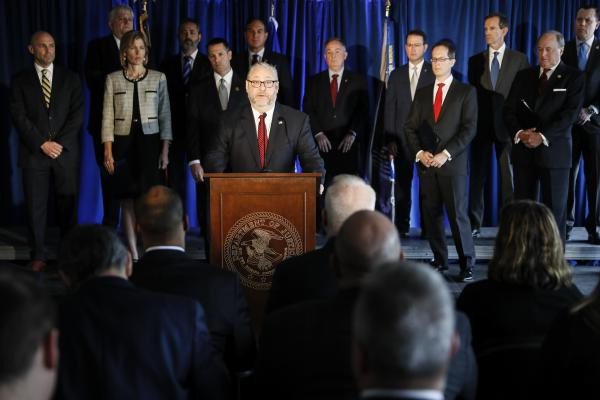 Brian Benczkowski, assistant attorney general of the Criminal Division, speaks beside members of Appalachian Regional Prescription Opioid Strike Force, during a news conference Wednesday, April 17, 2019, in Cincinnati.