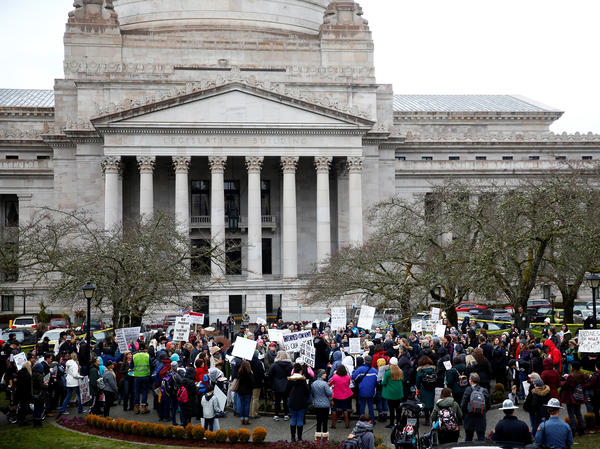 The Washington state Senate passed a bill on Wednesday that would remove the personal belief exemption from the required vaccinations for measles, mumps and rubella. Here, people protest the related house bill outside Washington's Legislative Building in Olympia in February.