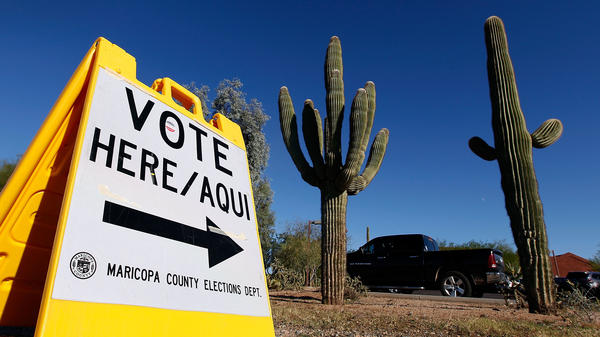 A sign directs voters to a polling station on Nov. 8, 2016, in Cave Creek, Arizona. The state is one of several considering new voting laws that could make it more complicated to vote in 2020.