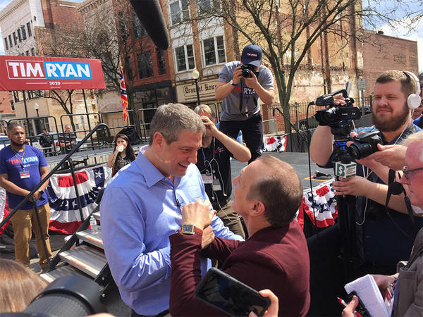 Congressman Tim Ryan talks to boxing legend and Youngstown native Ray 'Boom Boom' Mancini at Ryan's first presidential campaign rally held in downtown Youngstown. Ryan joked he would hire Mancini as his White House secretary.