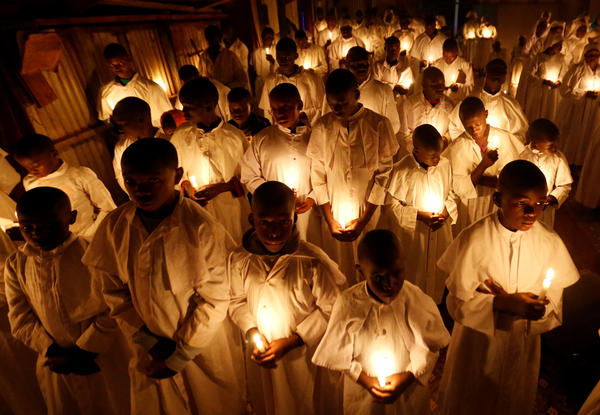 Christian faithful of the Legio Maria African Mission Church hold candles as they attend the Easter vigil Mass in their church in Nairobi, Kenya.