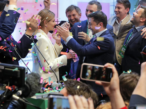 Ukrainian comedian Volodymyr Zelenskiy (center right) defeated incumbent Petro Poroshenko in a landslide.