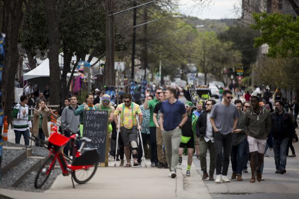 A crowd wanders down Rainey Street during SXSW in March.