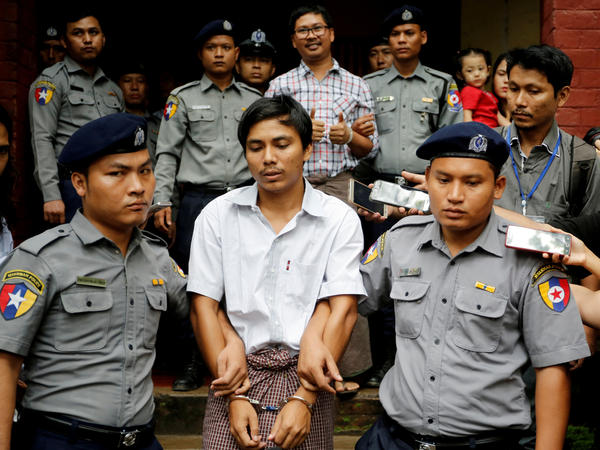Detained Reuters journalists Kyaw Soe Oo and Wa Lone are escorted by police as they leave after a court hearing in Yangon, Myanmar, in August. Myanmar's top court rejected their appeal Tuesday, letting their seven-year prison term stand.