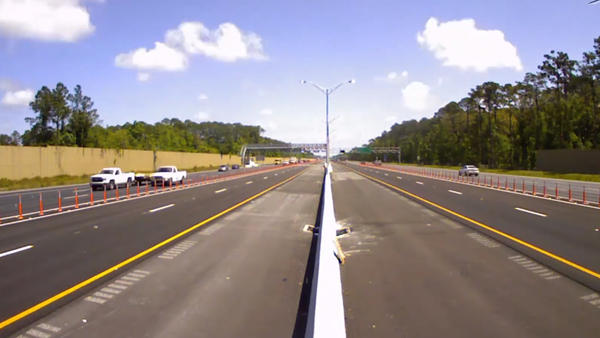 The FDOT has finished installing the short, pole-like delineators that separate the express lanes from the regular lanes.
