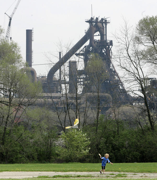 A child flies a kite near AK Steel's Middletown Works plant. J.D. Vance's book 'Hillbilly Elegy' provides a vivid tour of the world he grew up in, set mainly in the Ohio city hit hard by the decline of its dominant steelmaking company.