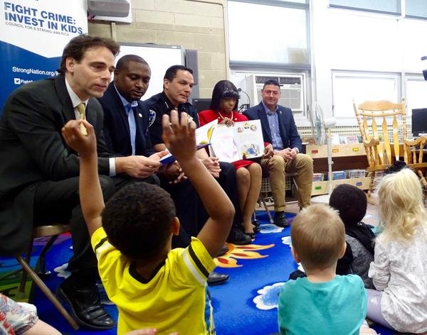 State Sen. Steve Stadelman, State Rep. Maurice West, Rockford Police Chief Daniel O'Shea, Winnebago County State's Attorney Marilyn Hite Ross, and State Rep. John Cabello, read to preschool children at the Summerdale Early Learning Center in Rockford,