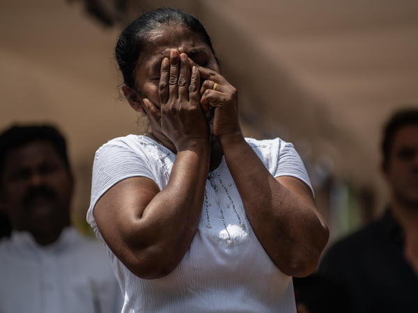 A woman is overcome with emotion as she attends the funeral of a person killed in the Easter Sunday attack on St. Sebastian's Church, on Wednesday in Negombo, Sri Lanka.