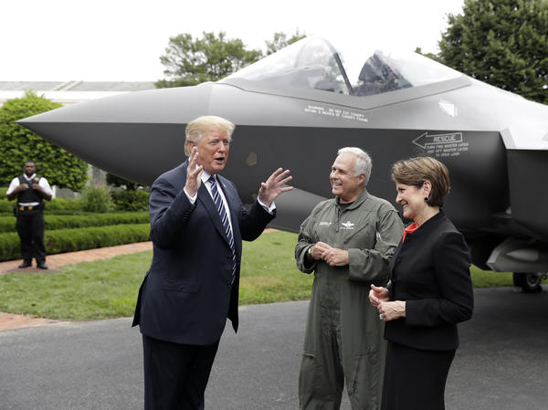 President Trump talks with Lockheed Martin President and CEO Marillyn Hewson and director and chief test pilot Alan Norman in front of an F-35 at the White House in July 2018.