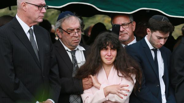 Family members attend the burial service for Lori Kaye, who was killed in the Chabad of Poway synagogue shooting on Saturday. The parents of the man accused in the shooting have condemned the attack as shocking and evil.
