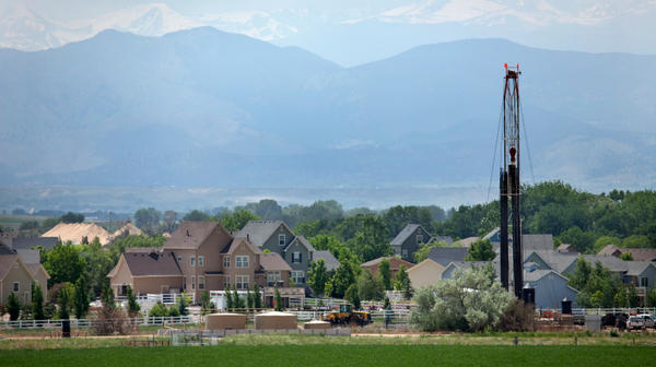 Just off Interstate Highway 25, Drill Rig 1548 of Encana Natural Gas stands near homes in the town of Frederick in Weld County, Colorado.