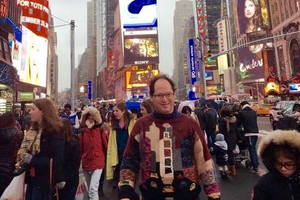 Barsky stands in New York City's Times Square wearing none other than his sweater of Times Square.