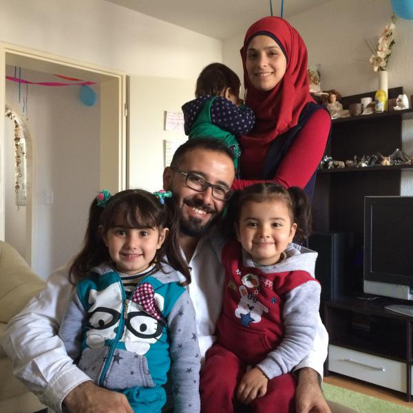 Syrian refugee Monzer Omar, 34, was recently reunited with his family in Germany. Wife Walaa Ahmed, 26, holds 14-month-old Lossin. Omar holds Lamar (left), age 4, and Lojain, 2.