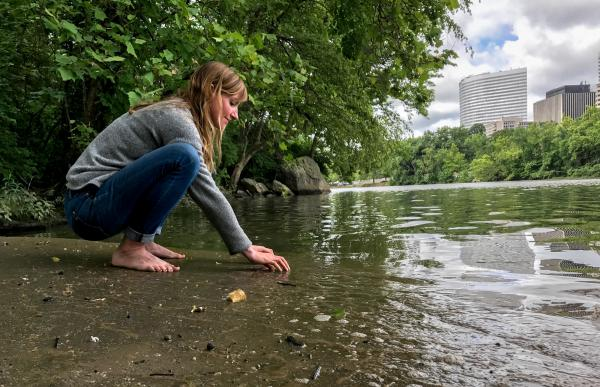 "Clare Kelley practices ""forest bathing"" along the edge of an urban forest on Roosevelt Island, in the middle of the Potomac River. In contrast to hiking, forest bathing is less directed, melding mindfulness and nature immersion to improve health."