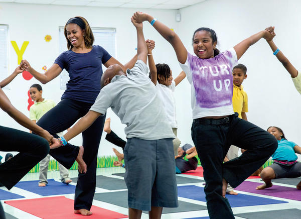 First Lady Michelle Obama joins children for a yoga class during a Let's Move! after-school activities event at Gwen Cherry Park in Miami, Florida, February 25, 2014. (Official White House Photo by Amanda Lucidon