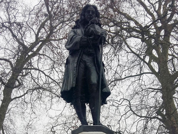 """A statue of Edward Colston towers over a square off Colston Avenue in Bristol, England. A small plaque calls Colston """"one of the most virtuous and wise sons"""" of the city. Officials plan to install another plaque explaining his links to the Atlantic slave trade."""