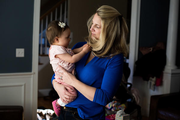 Alicia Nichols holds her daughter Diana in her home in February. After the birth of Diana, Nichols suffered unusual postpartum blood loss that she feels was not taken seriously by her doctor.