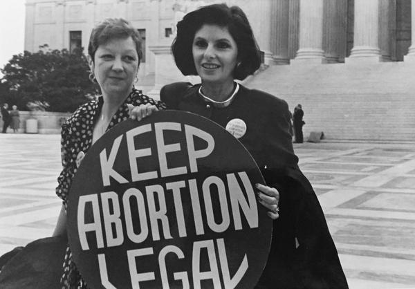 Norma McCorvey (Jane Roe) and her lawyer Gloria Allred on the steps of the Supreme Court, 1989.
