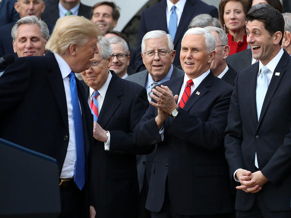 Donald Trump celebrates the passage of the Tax Cuts and Jobs Act.