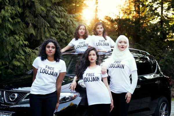 "Friends of Loujain al-Hathloul made a photo to parody a <em>Vogue </em>Arabia cover image showing a Saudi princess in a red convertible. Pictured here (left to right) are Ayendri Ishani Ridell, Urooba Jamal, Narissa Diwan, Atiya Jaffar and Rauza Khan. Hathloul ""took a huge risk to advance women's rights in her country,"" Jamal says, ""and now is facing the most heinous injustices."""