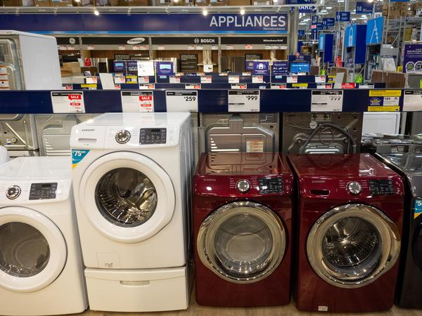 Overall, prices of major appliances tracked by the consumer price index are starting to tick down month-to-month. But they are still higher than they were last year. Washing machines, dryers and other appliances are seen for sale at a Lowe's home improvement store in Washington, D.C., in 2018.