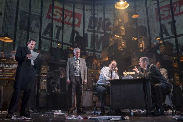 Bertie Carvel (left) plays a young Rupert Murdoch in the play <em>Ink, </em>which chronicles the media mogul's early attempts to upend the insular world of British newspaper publishing<em>. </em>Also pictured: Bill Buell, Jonny Lee Miller, Robert Stanton and Eden Marryshow.<em> </em>