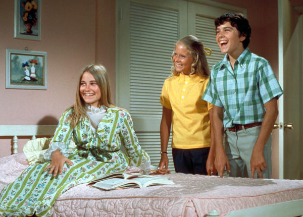 <em>The Brady Bunch,</em> circa 1970, with oldest sister Marcia seated in front. In one episode of the show from 1969, the sisters and brothers all stay home from school with measles.