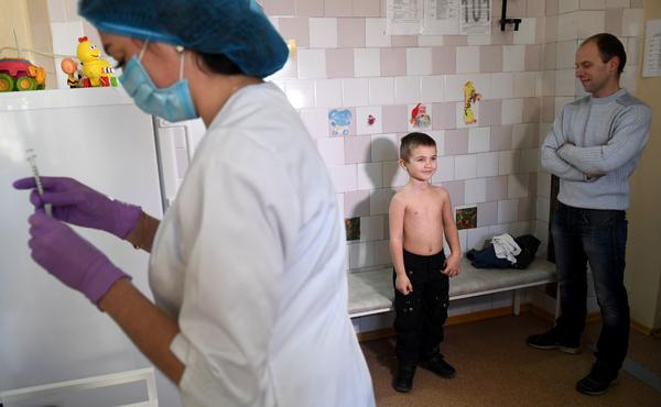 A nurse prepares a syringe for a measles vaccination at a pediatric clinic in Kiev, Ukraine. The country had 72,408 measles cases in the year from March 2018 to February 2019 — the highest number for any country during that period.