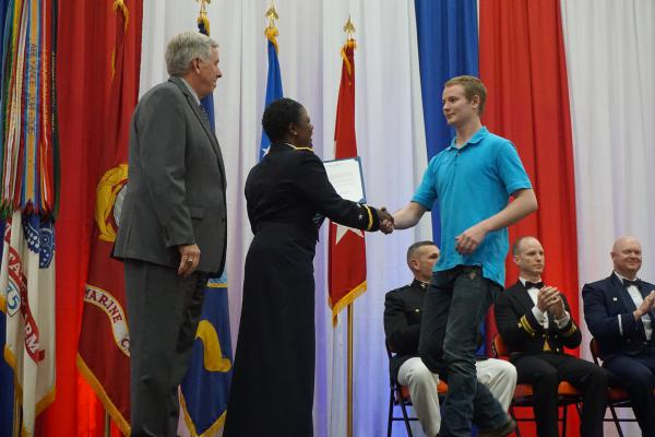 Steelville High School senior Caleb Dicus is honored for enlisting in the Army. Students from 12 high schools were recognized at the event by dignitaries including Gov. Mike Parson and Maj. Gen. Donna Martin, commander at Fort Leonard Wood.