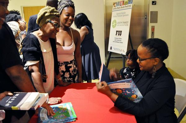 An author signs her book at last year's Little Haiti Book  Festival.