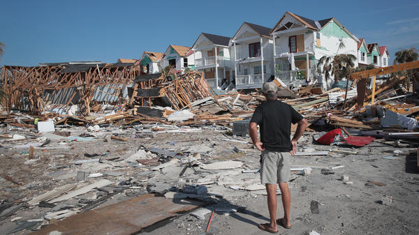 A resident of Mexico Beach, Fla., looks over damage caused to the Florida Panhandle by Hurricane Michael in October 2018.